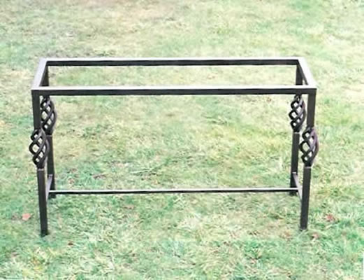 Wrought iron table base with baskets