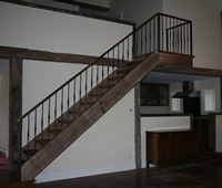 Steel Railing with faux oil rubbed bronze finish and real antiqued brass cap