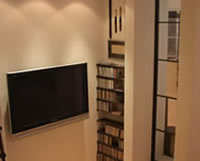 Media Room-iron shelves and side window partition